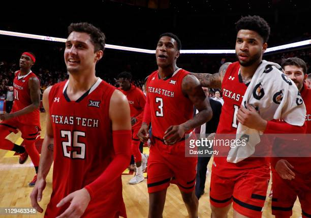 Texas Tech Red Raiders Tariq Owens Davide Moretti Deshawn Corprew Kyler Edwards run off the court after defeating the Iowa State Cyclones 8073 in the...