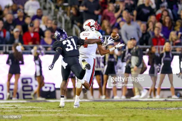Texas Tech Red Raiders wide receiver Antoine Wesley catches a deep pass with TCU Horned Frogs safety Ridwan Issahaku covering during the game between...