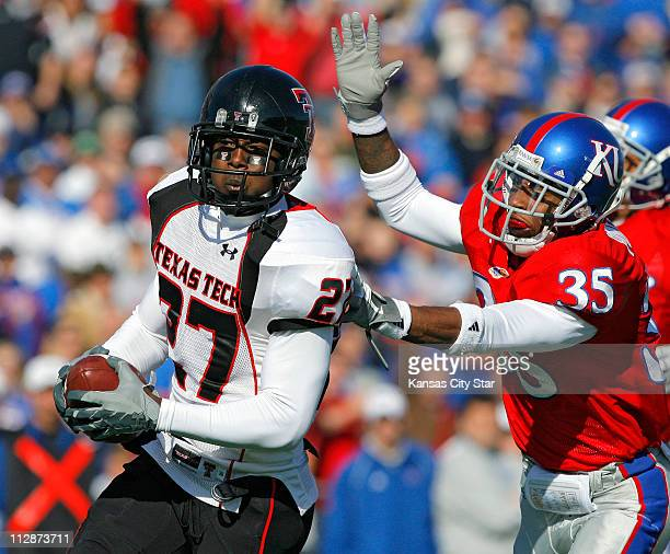 Texas Tech wide receiver Edward Britton heads for the end zone in front of Kansas cornerback Corrigan Powell for a first quarter touchdown on...