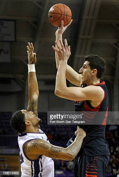 Texas Tech's Dejan Kravic right shoots over Texas Christian University defender Adrick McKinney in the second half at DanielMeyer Coliseum in Fort...