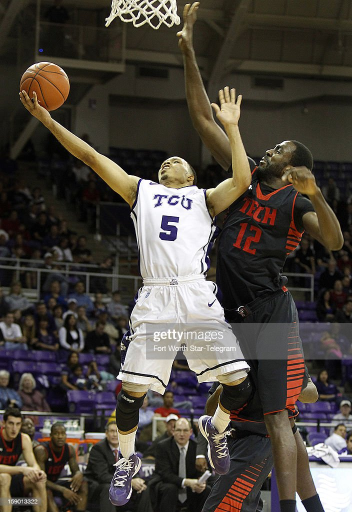 Texas Tech's Kader Tapsoba (12) blocks a shot by Texas Christian University's Kyan Anderson in the first half at Daniel-Meyer Coliseum in Fort Worth, Texas, Saturday, January 5, 2013. Texas Tech defeated TCU, 62-53.