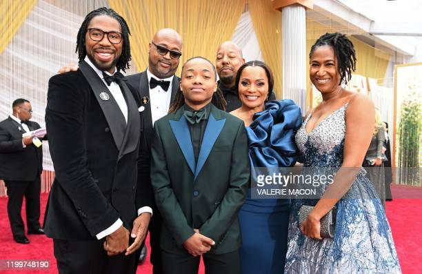 Texas teen Deandre Arnold poses with Karen Rupert and filmmakers of Hair Love as they arrive for the 92nd Oscars at the Dolby Theatre in Hollywood...