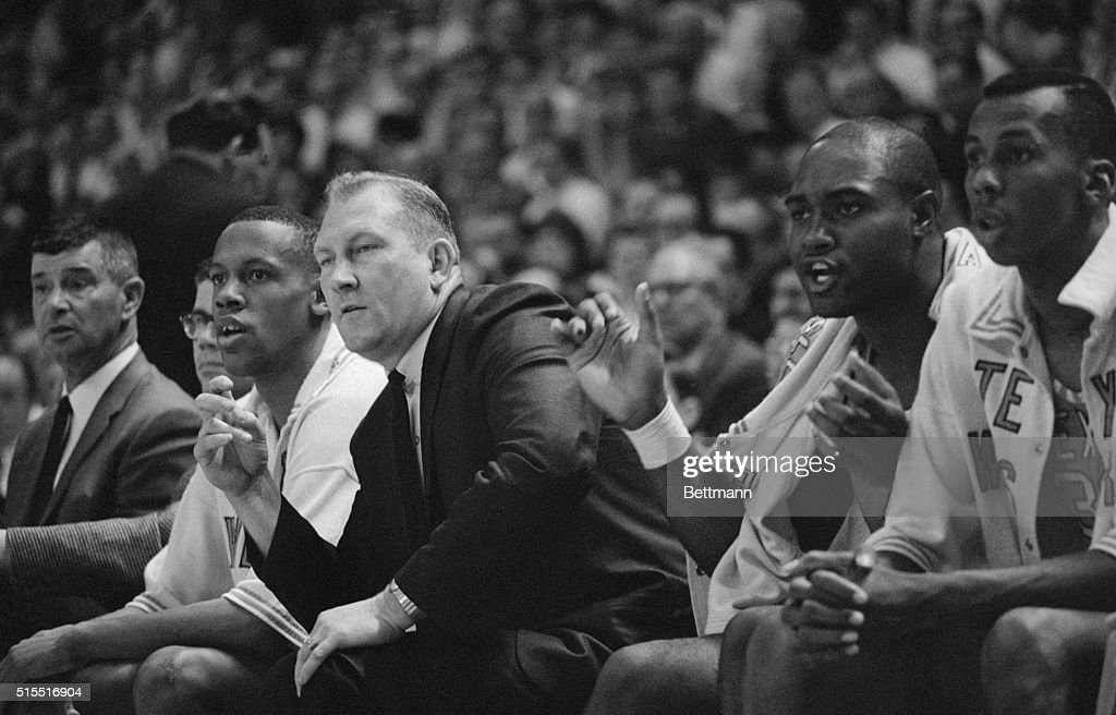 Texas Western coach Don Haskins, (R), and one of his players, Willie Cager, cheer on the Miners during the second game of the NCAA championship play offs at the University of Maryland. The Miners defeated Utah, 85-78, and were scheduled to play Kentucky in the finals.