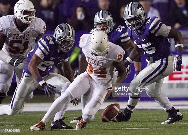 Texas wide receiver Marquise Goodwin fumbles the ball as Kansas State's Nigel Malone Jarell Childs and Adam Davis look to pounce in the fourth...