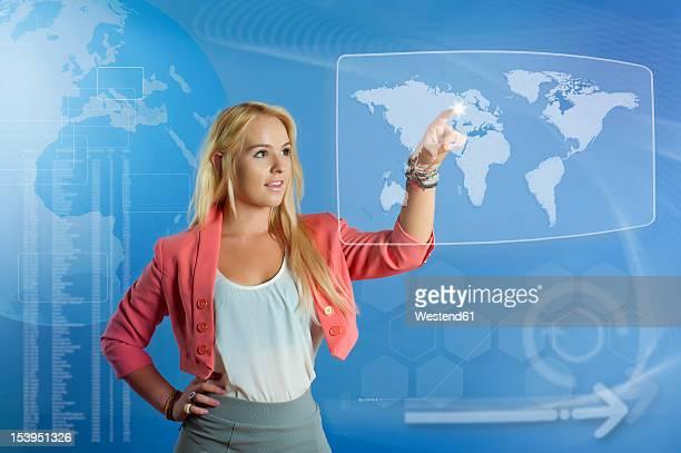 USA, Texas, Young woman using virtual screen