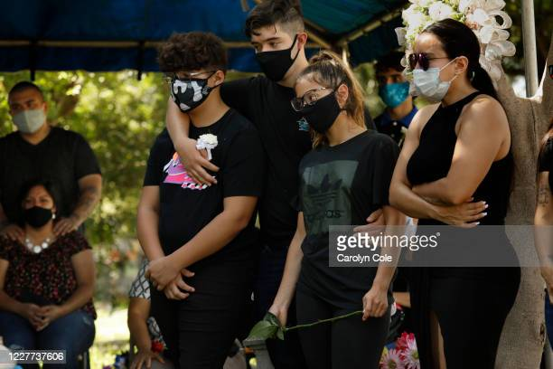 July 20, 2020-Family gather at the funeral of Fernando Aquirre who died of COVID-19 at the age of 69. A graduation party lead to many family members...