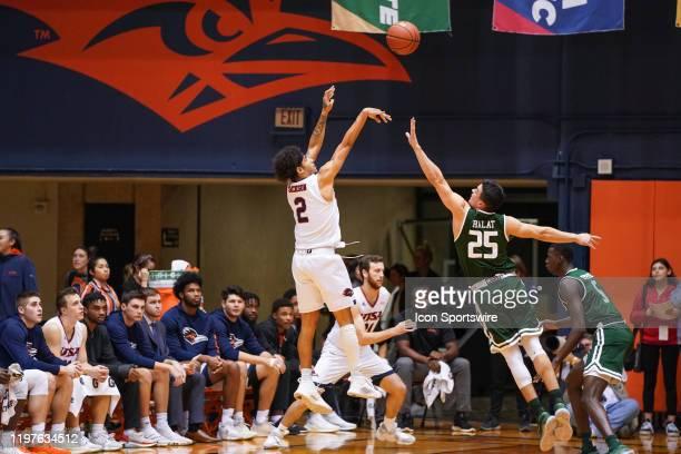 TexasSan Antonio Roadrunners guard Jhivvan Jackson shoots over UAB Blazers guard Antonio Ralat during the NCAA game between the UAB Blazers and the...