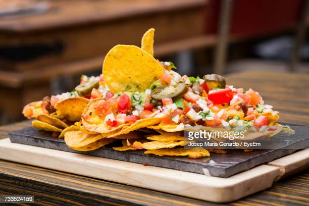 tex-mex on tray over table at restaurant - mexican food stock pictures, royalty-free photos & images