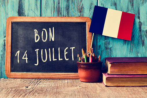 text bon 14 juillet, happy 14th of July in French 544589620