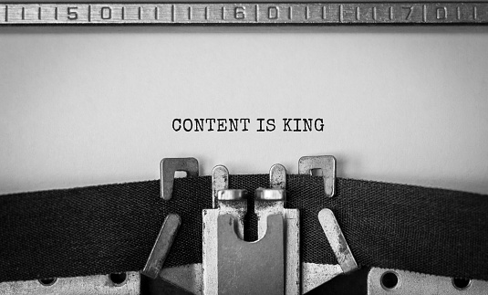 Text Content is King typed on retro typewriter 1179510163