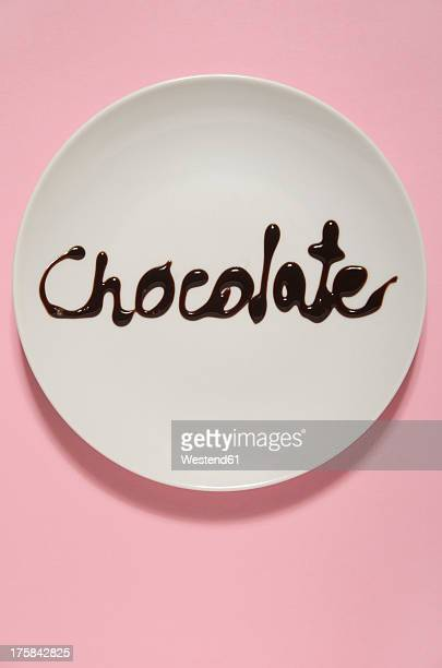 Text form with chocolate sauce on plate