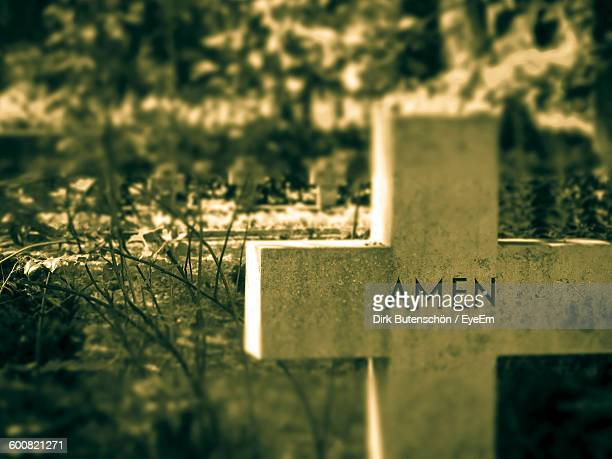 Text In Cross At Cemetery