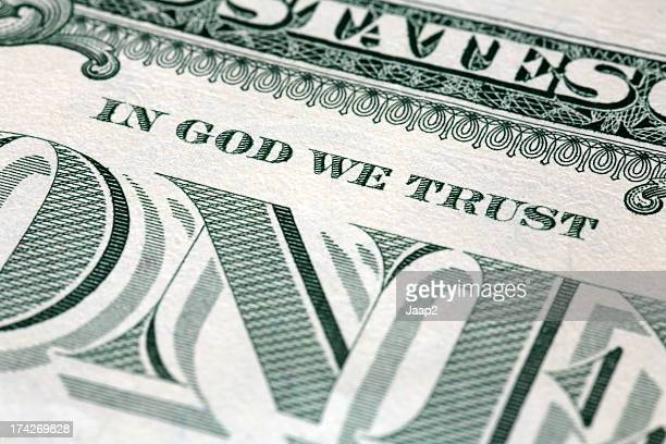 Text 'IN GOD WE TRUST' on US one Dollar note