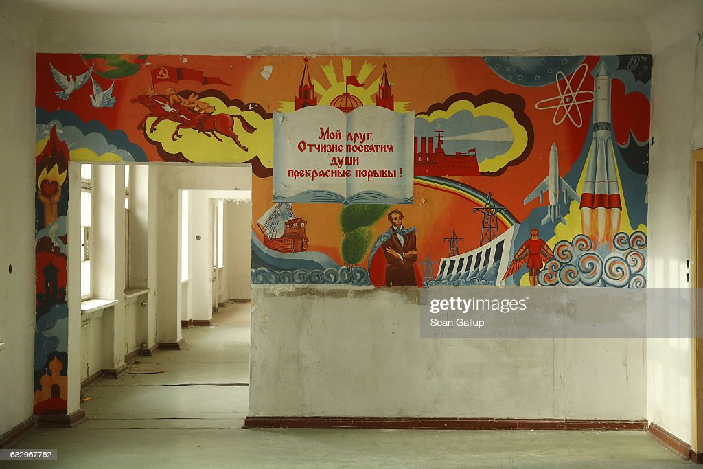 A text in Russian from Alexander Pushkin's poem 'To Chadaev' reads: 'My friend, to our land we dedicate the soul's exquisite raptures!' on a mural in the officers' building at the former Soviet military base on January 26, 2017 in Wuensdorf, Germany. Wuensdorf, once called 'The Forbidden City,' was the biggest base for the Soviet armed forces in communist East Germany from 1945 until the last Soviet troops left in the early 1990s following the end of the Cold War and the reunification of Germany. While Soviet troops pulled out of eastern Europe after 1989, Russian troops have in recent years intervened in Ukraine. The NATO military alliance has strengthened its presence in the Baltic states in an effort to prevent similar Russian intervention there.