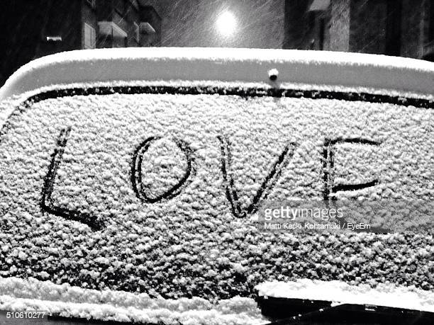 Text love Writing on frozen windshield