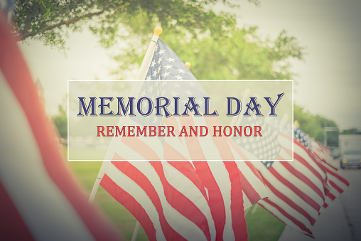Text Memorial Day and Honor on row of lawn American Flags 954249062