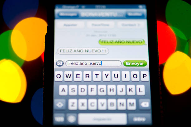a text message sms of new year greetings in spanish is pictured on a