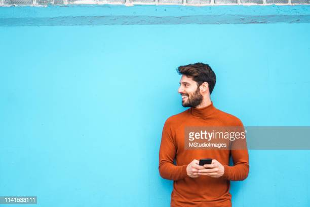 text messaging. - young men stock pictures, royalty-free photos & images