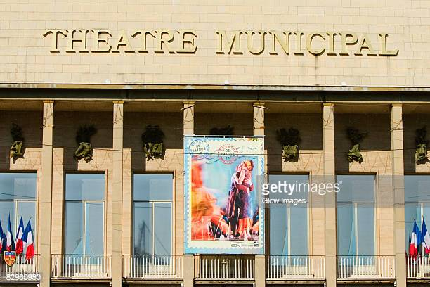 text mounted on the wall of a movie theater, theatre municipal, le mans, sarthe, france - film poster stock pictures, royalty-free photos & images