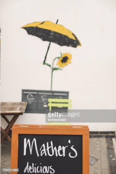 text on blackboard against wall - cristian neri foto e immagini stock
