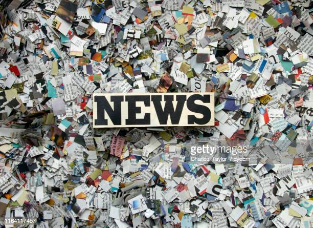 text on block with torn newspapers - news not politics stock pictures, royalty-free photos & images