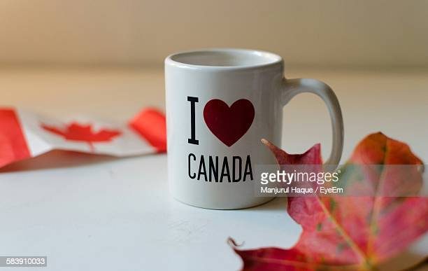text on coffee cup - traditionally canadian stock pictures, royalty-free photos & images