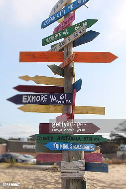 Text On Directional Colorful Wooden Sign