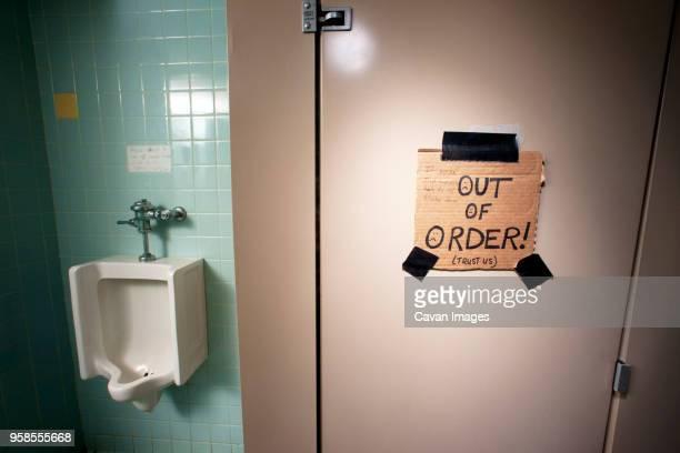 Text on door of public restroom