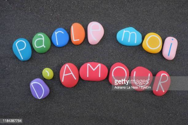 text on multi colored pebbles - paris rocks stock pictures, royalty-free photos & images