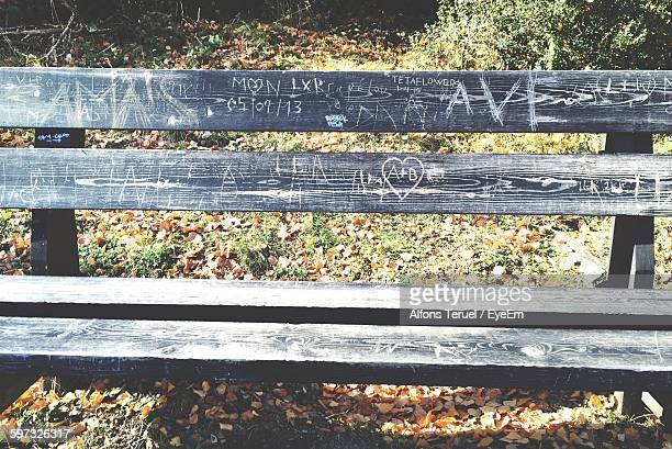 Text On Wooden Bench At Park During Autumn