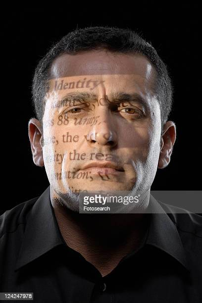 Text projected on man's face