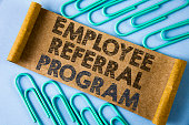 Text sign showing Employee Referral Program. Conceptual photo strategy work encourage employers through prizes written on Folded Cardboard paper piece on plain blue background within Paper Pins.