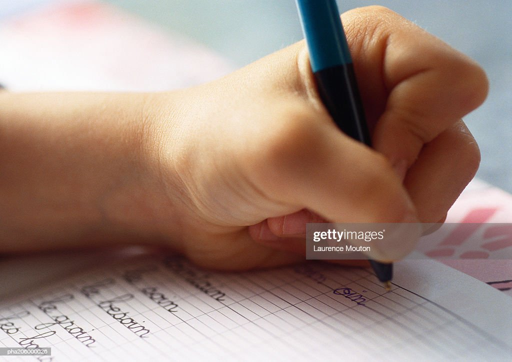 Textbook and ballpoint  pen. : Stockfoto