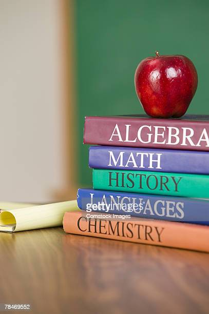 Textbooks and an apple