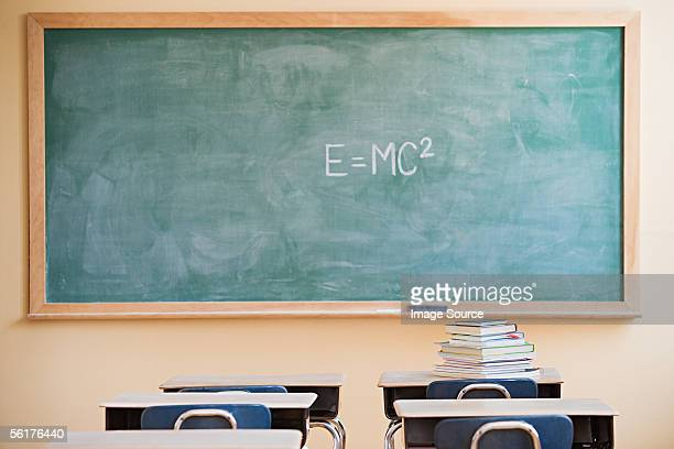 textbooks and blackboard in classroom - blackboard stock photos and pictures