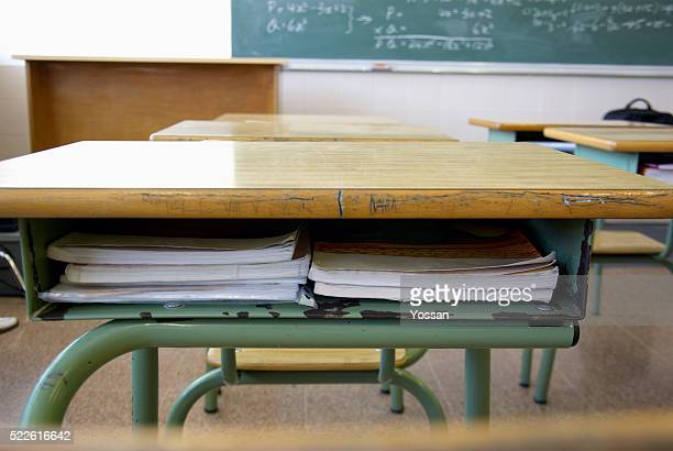textbooks in school desk - education stock pictures, royalty-free photos & images
