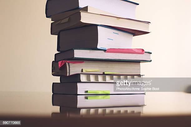 textbooks stacked on table - textbook stock pictures, royalty-free photos & images