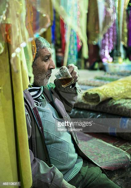 CONTENT] A textile and carpet dealer is waiting for a customer Bazaare Vakil Shiraz Iran 29th December 2013