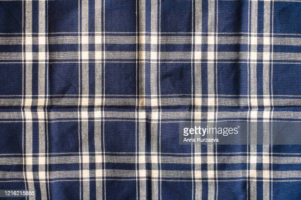 textile background with a checkered blue napkin, top view. natural textile background. fabric texture background. texture of natural linen fabric. - checked pattern stock pictures, royalty-free photos & images