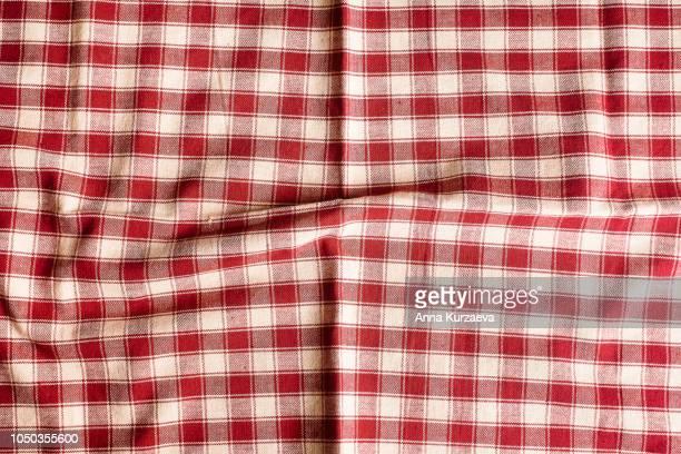 textile background with a checkered red napkin, top view. natural textile background. fabric texture background. texture of natural linen fabric. - quadriculado - fotografias e filmes do acervo