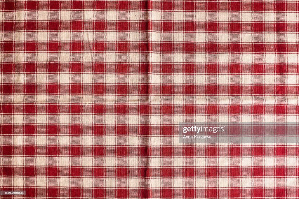 Textile background with a checkered red napkin, top view. Natural textile background. Fabric texture background. Texture of natural linen fabric. : Stock Photo