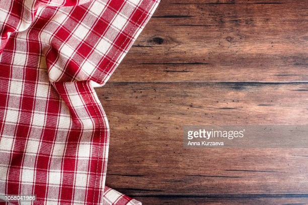 textile background with a checkered red napkin, top view. natural textile background. fabric texture background. texture of natural linen fabric. - checked pattern stock pictures, royalty-free photos & images