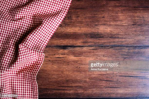 textile background with a checkered red napkin, top view. natural textile background. fabric texture background. texture of natural linen fabric. - geblokt stockfoto's en -beelden