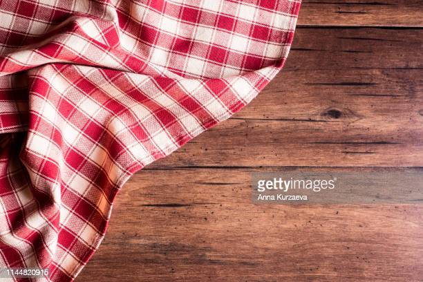 textile background with a checkered red napkin, top view. natural textile background. fabric texture background. texture of natural linen fabric. - タータンチェック ストックフォトと画像