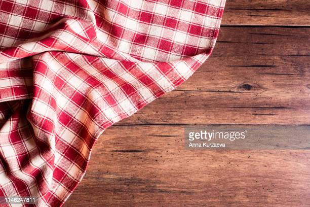 textile background with a checkered red napkin, top view. natural textile background. fabric texture background. texture of natural linen fabric. - country christmas stock pictures, royalty-free photos & images