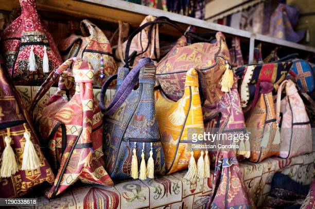 textile backpacks and bags with oriental ornament, cappadocia, turkey. - royal tour stock pictures, royalty-free photos & images