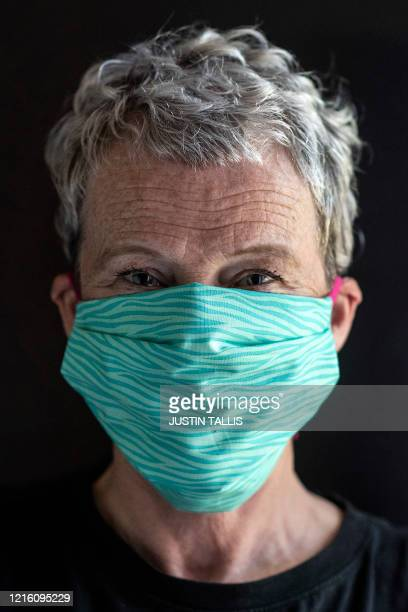 Textile designer Corinne McManus cofounder of the sewing collective Masks for Extraordinary People poses for a portrait wearing one of their masks in...