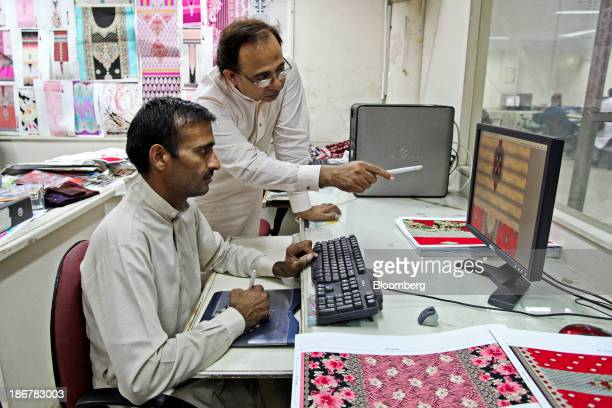 Textile designers work on a computer drawing in the design department at the Faisal Fabrics Ltd factory in Khurrianwala Punjab Pakistan on Saturday...