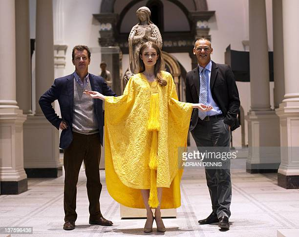 Textile expert Simon Peers and fashion designer Nicholas Godley stand beside model Bianca Gavrilas as she wears a handembroidered cape made from the...