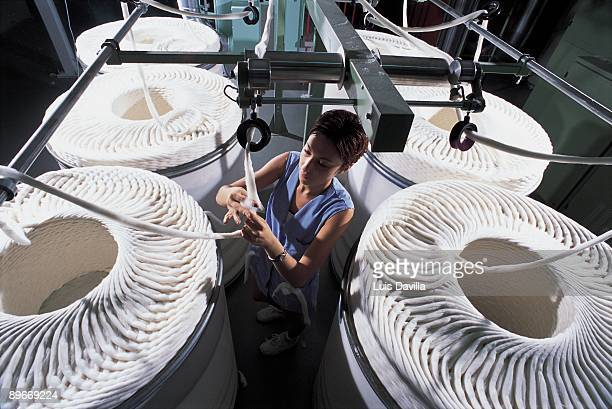 Textile factory Saez Merino Worker of the company of clothes Lois manipulating industrial reels of cotton